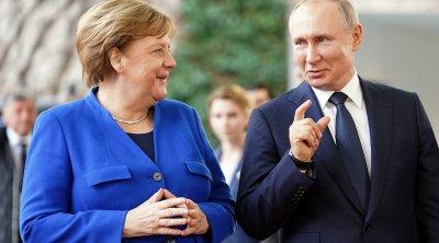 Merkel Putinlə bağlı yeni sirri açdı